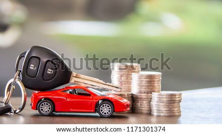 red car  and key on stacks of coin,  car loan concept,  Saving money for car concept,  trade car for cash concept, finance concept. #1171301374
