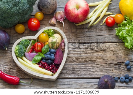 Healthy food in heart diet cooking concept with fresh fruits and vegetables #1171306099