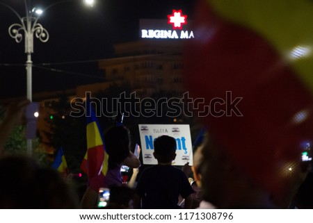 BUCHAREST, ROMANIA - 12 AUGUST 2018: Unknown protesters in Piata Victoriei, protesting agains government corruption, after the riot police forceful intervention on 10th of August. Bucharest, Romania #1171308796