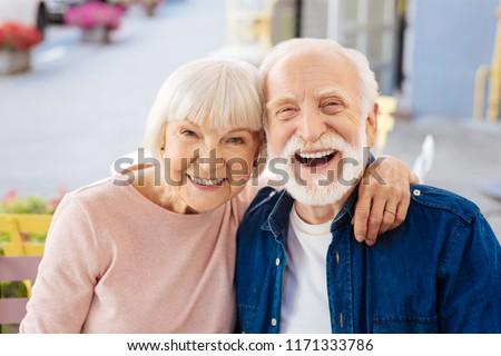 Strong relationships. Gay senior couple making laugh and looking at camera #1171333786