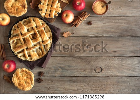 Homemade Apple Pies on rustic background, top view, copy space. Classic autumn Thanksgiving dessert - organic apple pie. #1171365298