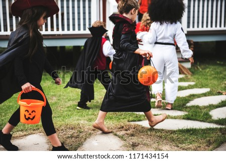 Young kids trick or treating during Halloween #1171434154