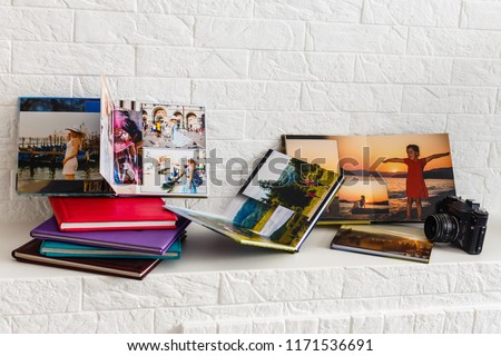 albums with photos of travel and vintage old camera Royalty-Free Stock Photo #1171536691