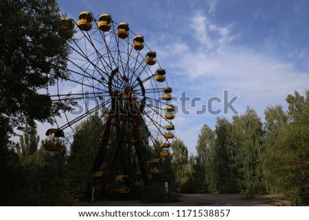 Abandoned ferris wheel in the town fair of ghost town Pripyat, Chernobyl, Ukraine. #1171538857