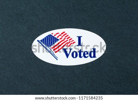 'I Voted' sticker on the black background. #1171584235