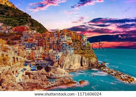 sunset over the town of Manarola delle Cinque Terre in Liguria Italy #1171606024