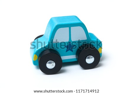 closeup of blue miniature wooden car on white background - concept police