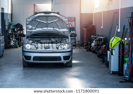 Vehicle repair shop with car and tools. Car service. Royalty-Free Stock Photo #1171800091