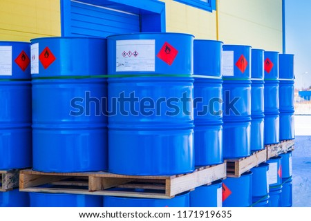 Barrels. Warehouse of chemical products. The metal barrels are blue. Chemistry. Manufacture of chemicals. Pallets with barrels. #1171919635