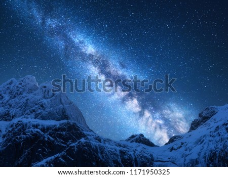 Milky Way above snowy mountains. Space. Fantastic view with snow covered rocks and starry sky at night in Nepal. Mountain ridge and sky with stars in Himalayas. Landscape with bright milky way. Galaxy #1171950325