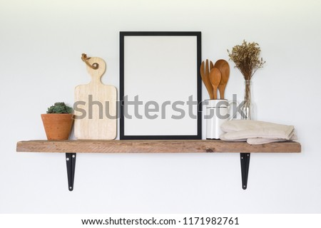 Frame poster with kitchen tools on wooden shelf.cooking concept