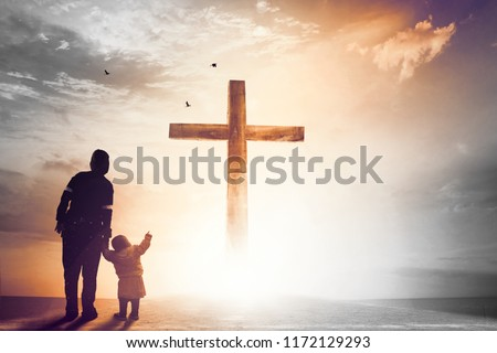 Praise and worship concept:Silhouette of Christian prayers raising hand while praying to the Jesus