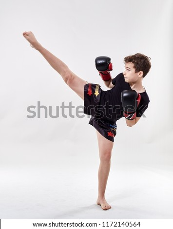 Young boy muay thai fighter in various postures Royalty-Free Stock Photo #1172140564