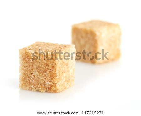 Brown cane sugar cubes #117215971