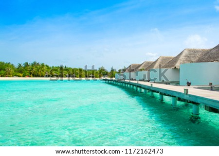 Beautiful landscape of over water villas, Maldives island, Indian Ocean #1172162473