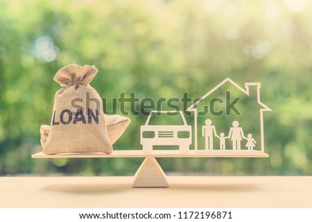 Family financial management, mortgage and payday loan or cash advance concept : Loan bags, family in a house on balance scale, depicts short term borrowing, high interest rate based on credit profile #1172196871