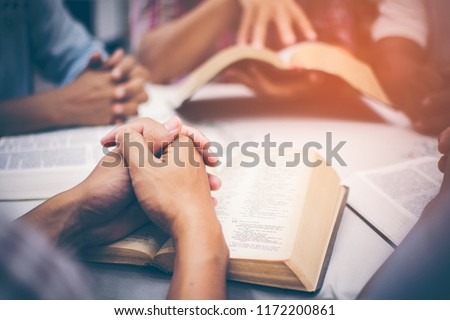 Christians are congregants join hands to pray and seek the blessings of God, the Holy Bible. They were reading the Bible and sharing the gospel with copy space. #1172200861