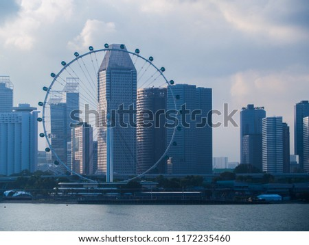 SINGAPORE, SINGAPORE - JULY 30, 2017: Singapore Flyer ferris wheel on Marina Bay Singapore. #1172235460
