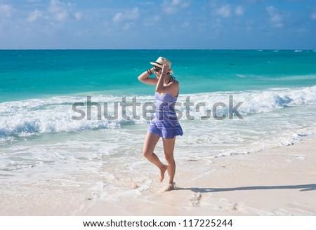 Beautiful girl on the beach #117225244