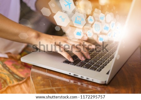Hand pressing modern laptop with Internet of things (IOT) objects icon connecting together coming out monitor, Internet networking concept, Connect global wireless devices with each other. Royalty-Free Stock Photo #1172295757