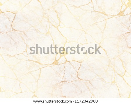 White marble or travertine with golden veins. Irregular destroyed surface. Attractive background for wedding and luxury projects. Seamless texture.  #1172342980
