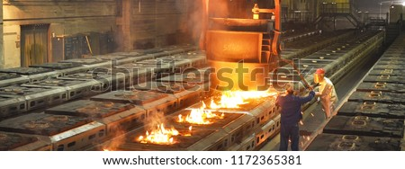 Production of metal components in a foundry - group of workers #1172365381