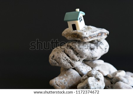 house on the edge of the abyss on a black background. The concept of a dangerous situation in life and critical grievances. the concept of a catastrophe and a critical situation