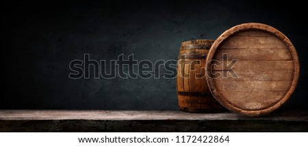 Oktoberfest beer barrel and beer glasses with wheat and hops on wooden table #1172422864