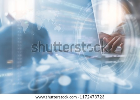 Coding software developer working on laptop computer, programming internet application with modern tech interface. Digital technology development, business and technology concept #1172473723