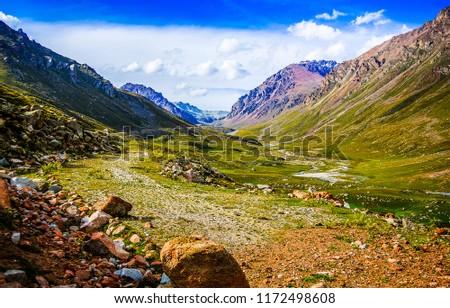 Mountain valley landscape. Mountain rocks in mountain valley panorama. Mountain valley view #1172498608