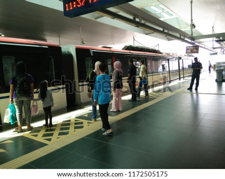 Kuala Lumpur, Federal Territory, Malaysia 12nd. August 2018 - people waiting for train door open, photo taken at light rail transport station #1172505175