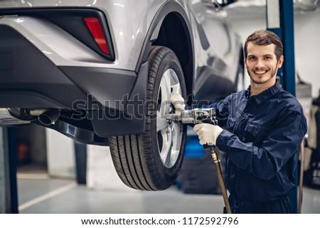Auto car repair service center. Mechanic at work #1172592796