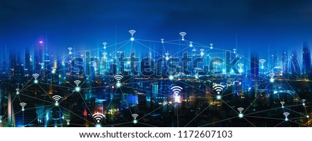 Wireless network and Connection technology concept with Bangkok city background at night in Thailand, panorama view Royalty-Free Stock Photo #1172607103