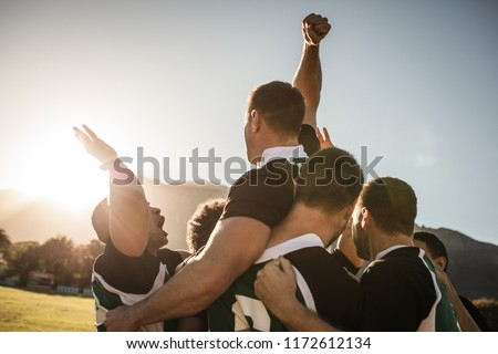 Rugby players lifting the teammate after winning the game. Rugby team celebrating the victory. Royalty-Free Stock Photo #1172612134