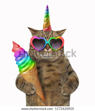 The cat unicorn in glasses is holding rainbow ice cream. White background.