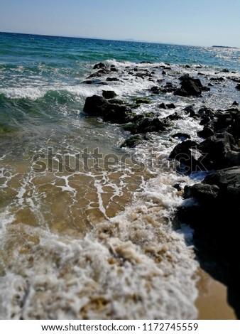 aquatic sport beach beauty in Nature horizon over water Land motion #1172745559