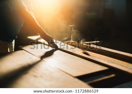 home improvement ideas concept with carpenter work with sawing wood machine site construction background #1172886529