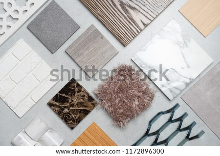 samples of material, wood , on concrete table.Interior design select material for idea. Royalty-Free Stock Photo #1172896300