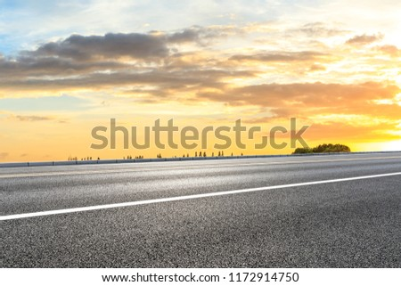 Clean asphalt highway and beautiful sky clouds at sunset #1172914750