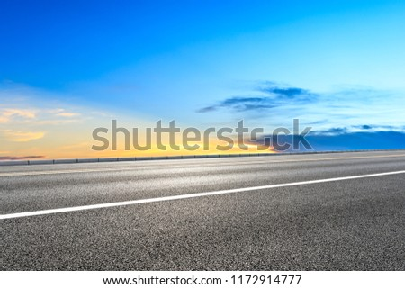 Clean asphalt highway and beautiful sky clouds at sunset #1172914777