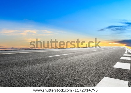 Clean asphalt highway and beautiful sky clouds at sunset #1172914795
