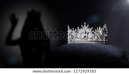 Diamond Silver Crown for Miss Pageant Beauty Contest, Crystal Tiara jewelry decorated gems stone and abstract dark background on black velvet fabric cloth, Macro photography copy space for text logo #1172929183