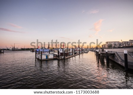 HAMBURG, GERMANY - JULY 03, 2018:  Elbe Philharmonic Hall (Elbphilharmonie) and River Elbe panorama in summer at sunset. The Elbphilharmonie is a concert hall in the HafenCity quarter. #1173003688