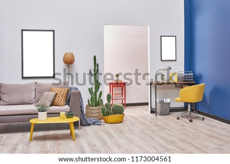 Blue and white wall room furniture decorative home concept. working table and sofa. Studio home apartment style. #1173004561