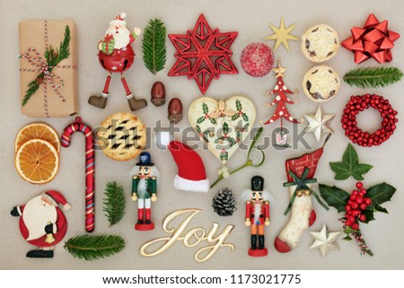 Christmas joy sign with retro bauble decorations, winter flora and traditional symbols of the festive season on mottled cream background. Top view. #1173021775