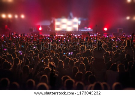 people at the concert with the phones shoot the show #1173045232