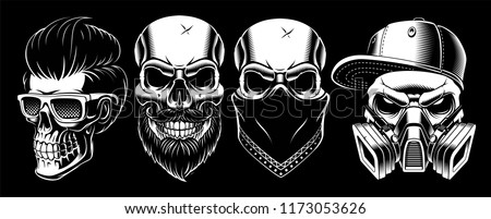 Set of vintage skulls, isolated on dark background.