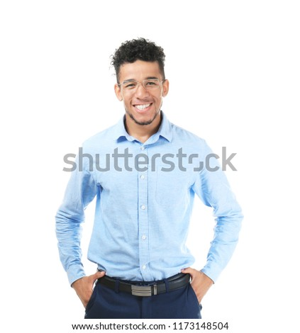 Handsome African-American man in formal clothes on white background #1173148504