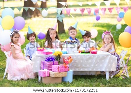 Cute children celebrating birthday outdoors #1173172231