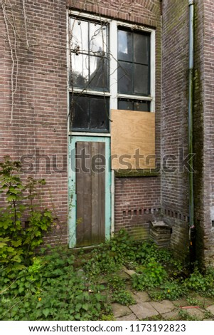 Abandoned Industrial Door #1173192823